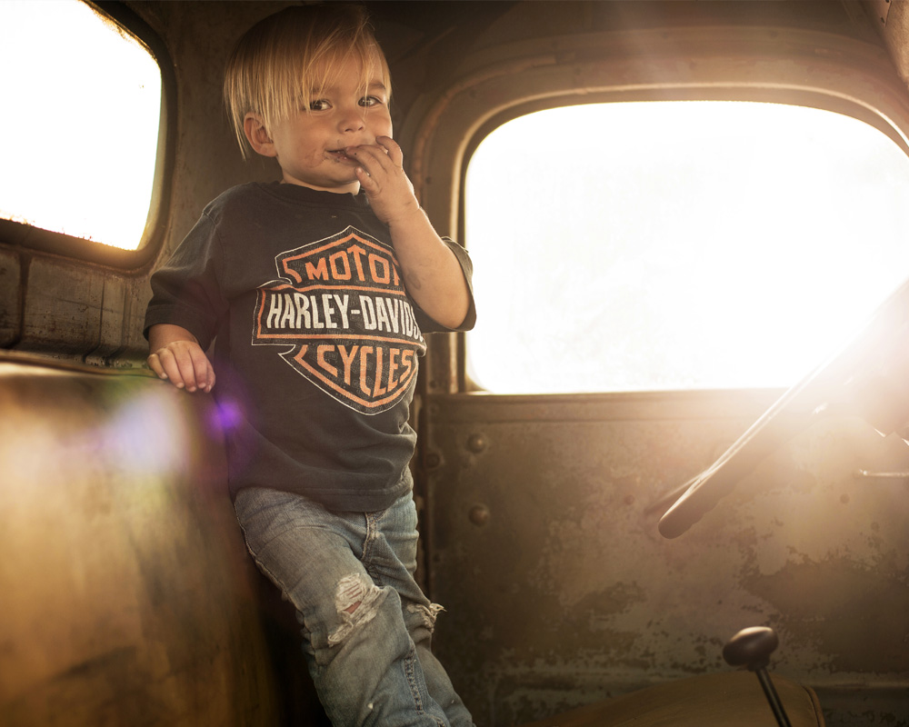 Young boy in old truck
