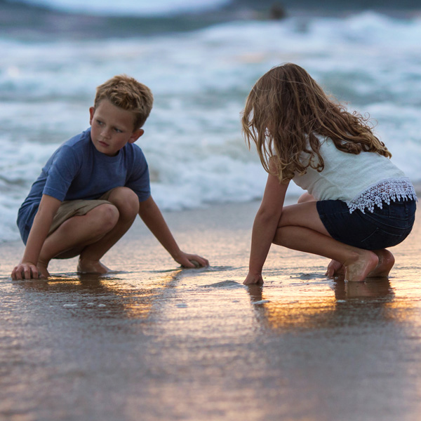 Young boy and girl on the beach