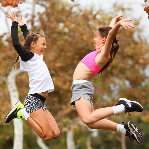 Two girls jumping