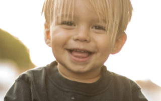 Smiling child on skateboard
