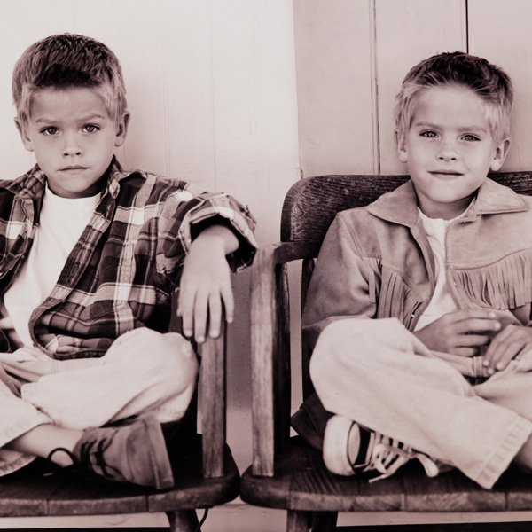 Twin boys sitting on chairs