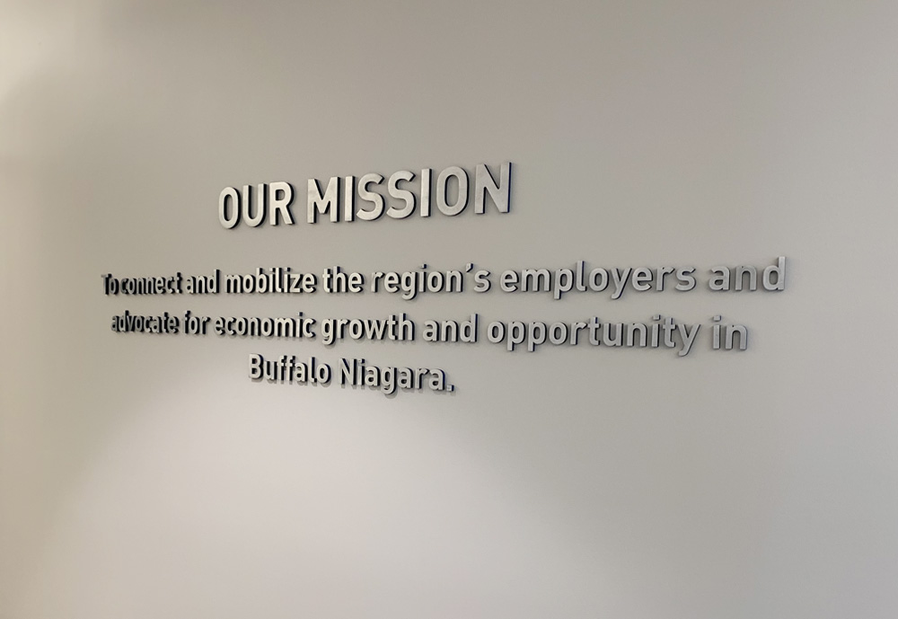 This wall displays 3D machined aluminum letters with the sides painted the corporate blue of the Buffalo Niagara Partnership.