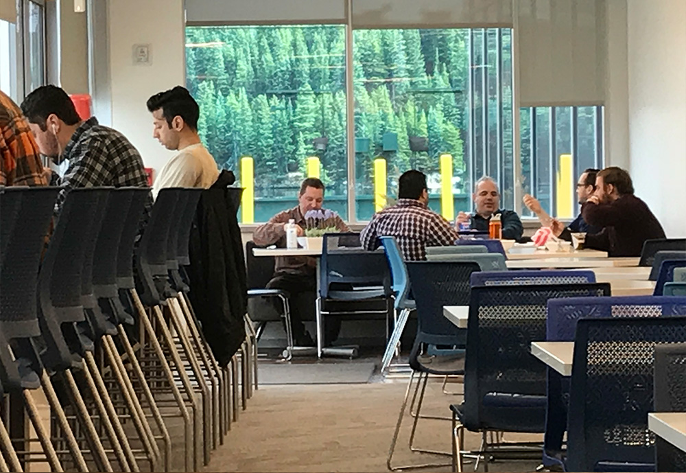 A beautiful lake with forestis seen from dining area, but in actuality it is the building's generator.