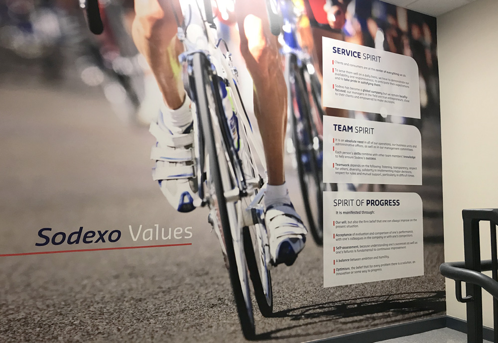 Sodexo values on Tour de France image. Sodexo has performed logistics and dining solutions for the tour for many years.