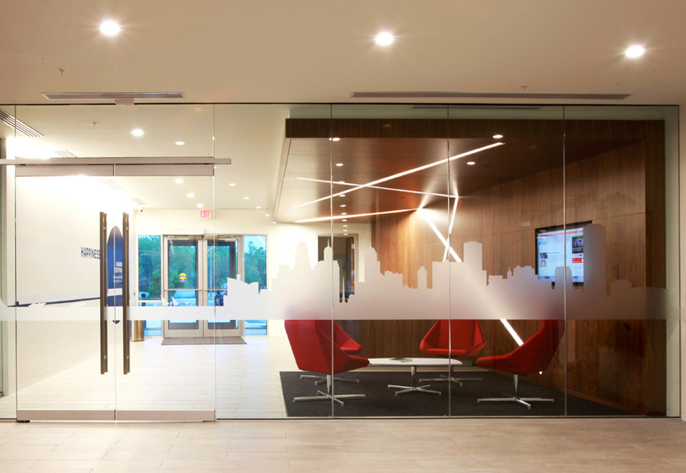 The vinyl graphics on the glass walls of the lobby depict the Buffalo skyline and Niagara River.