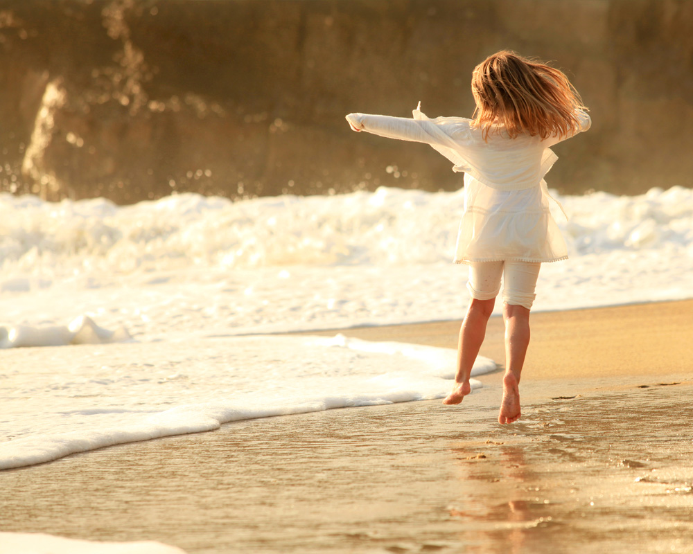 Girl playing in surf