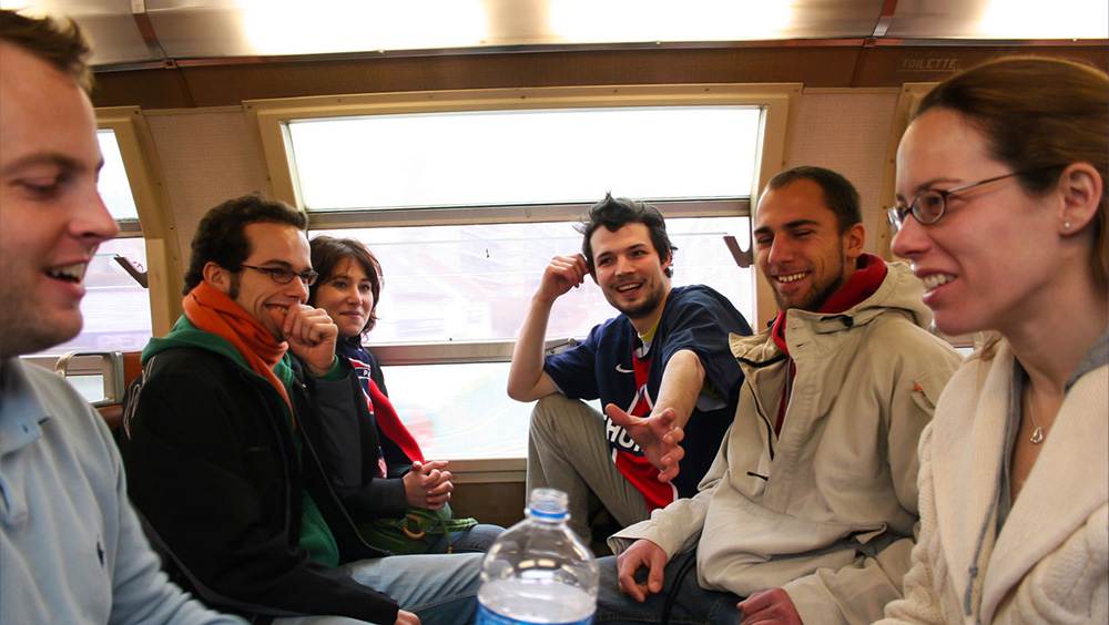 Editorial image, friends on train from Versailles to Paris, France.