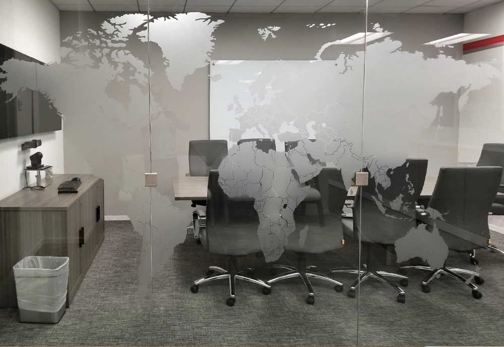 Vinyl frost countries as privacy screen for global company.